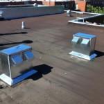 Évacuation sur toiture en asphalte